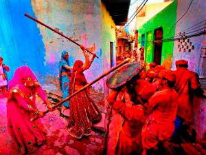 Barsana Lath maar Holi where women hit men with sticks and men have to save themselves with shield